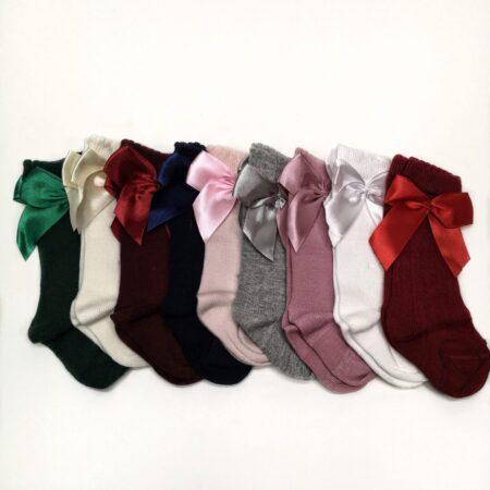 meias altas com laço
