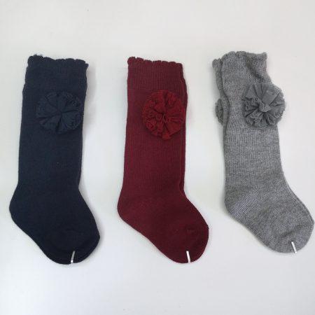 meias altas com laço pompom